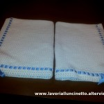 Copertina in lana bianca per passeggino